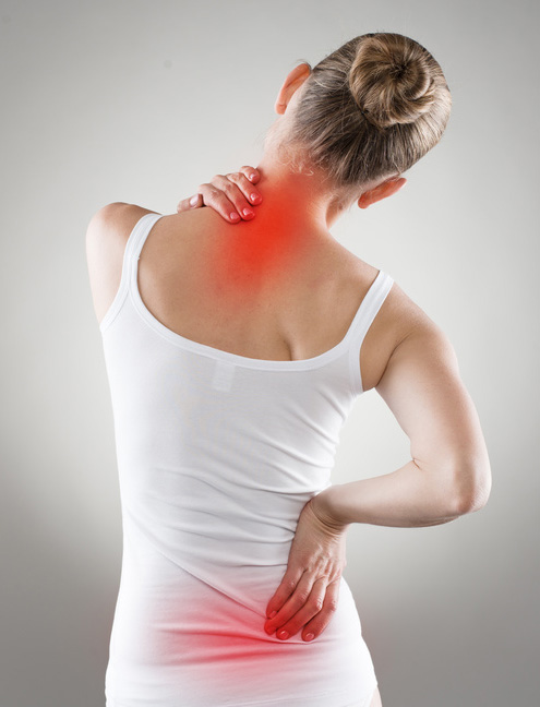 Woman holding her neck and lower back in pain