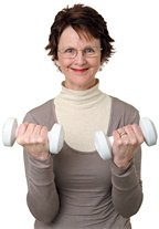 Older woman holding to small dumbbells. - Copyright – Stock Photo / Register Mark